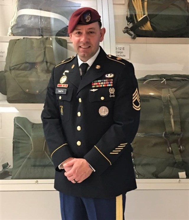 The late Sgt. 1st Class James Smith posed for a photograph in his Army Service Uniform in front of a paratrooper equipment display at Fort Lee, Va. in 2015. Sarah Smith took part in the 94th Training Force Sustainment Headquarters and Headquarters Company virtual suicide prevention training. She shared her story about the loss of her husband due to suicide. The 94th TD-FS HHC suicide prevention training was conducted on Oct. 24, 2020.If you or someone you know is in crisis, contact the National Suicide Prevention Lifeline at (800) 273-8255 or Military Crisis Line, free support for all Service members, including members of the National Guard and Reserve, and all Veterans at (800) 273-8255.