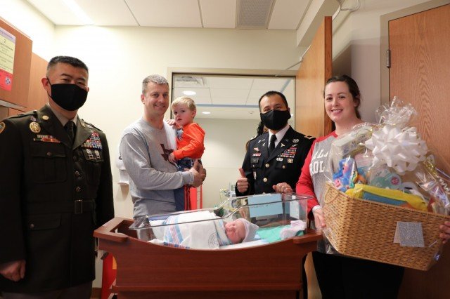 Hudson S. McMullan, the first baby born in Brian D. Allgood Army Community Hospital (BDAACH) in 2021, receives a welcome visit from the Hospital Command team on Jan. 2, 2020.