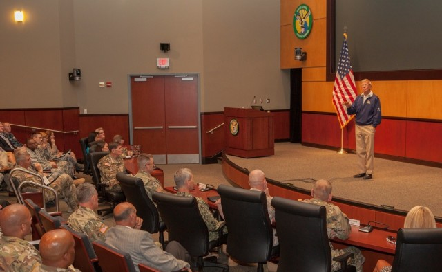 Lou Holtz speaks to service members June 21, 2016, at U.S. Central Command headquarters at MacDill Air Force Base, Fla.