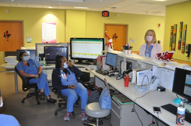 Martin Army Community Hospital ObGyn Nurse Marcella Hannah talks to staff in Labor and Delivery Unit.