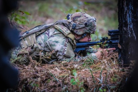 A Soldier takes aim while engaging in realistic training at Fort Polk, La., Nov. 9, 2020.