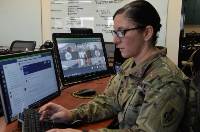 Master Sgt. Catherine Adams, a Master Leader Course facilitator at the NCO Leadership Center of Excellence, works on curriculum and course programming while students engage in dialogue via Microsoft Teams, Dec. 8. While the traditional two-week MLC Resident Course is usually held in a face-to-face setting, the MLC program coordinators at the NCOLCoE made necessary changes to enable the course in a virtual setting.