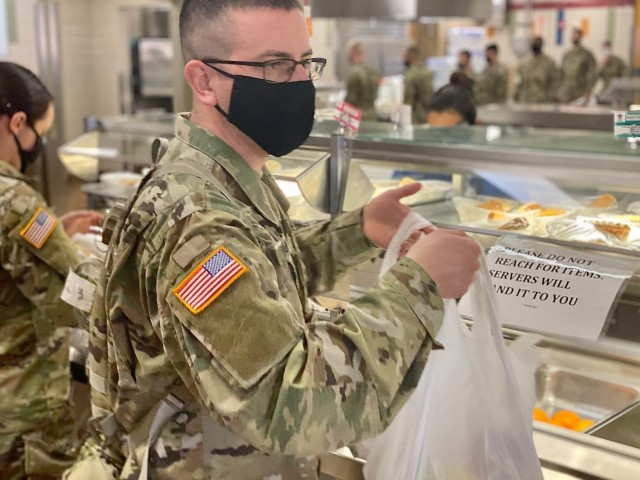 "Soldiers in Advanced Individual Training at Fort Huachuca are taking all of their meals to go under Brig. Gen. Anthony R. Hale's new General Order Number 8 implemented Monday, January 4, 2021.The new general order restricts all personnel on the fort from indoor dining at establishments both on and off of the installation, including military dining facilities.""The outdoors are open,"" said Hale in a meeting with commanders about the new restrictions. ""I fully support our Soldiers getting out into the fresh air to eat their meals in a socially distanced manner that reduces their exposure to, and possible spread of COVID-19. They can also take their items back to their barracks if they prefer to eat there.""Hale aims to recreate a protective bubble around the training population as they return to their studies after a two-week Holiday Block Leave.The policy will be reevaluated after two-weeks to determine continuation of the tighter restrictions or a return to more relaxed measures. (Released/ U.S. Army Photo by Meredith Mingledorff)"