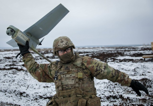 Sgt. Zachary Briley, a Cavalry Scout assigned to 2nd Battalion, 8th Cavalry Regiment, 1st Armored Brigade Combat Team, 1st Cavalry Division, gets ready to launch a drone, commonly called a Raven, Dec. 22, 2020, at the Pabrade Training Area, Lithuania. The drone played a support role during a live fire demonstration that showcased the battalion's lethality on the battlefield.
