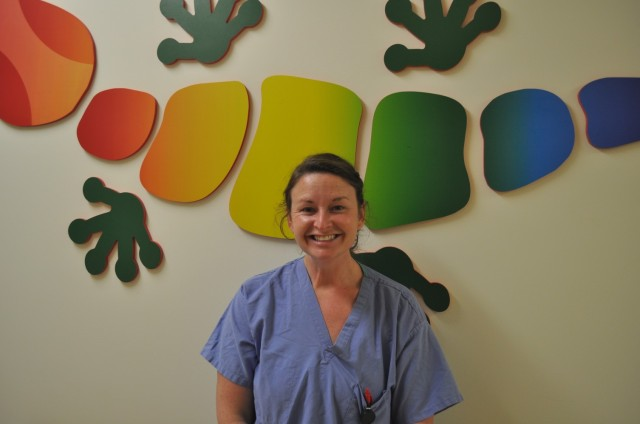 Fort Benning Martin Army Community Hospital Director of Pediatrics Maj. Jessica Aguilar pictured in front of mural in Pediatrics Department.