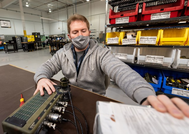 Frederick Orlando, electronics worker, tests the power module for the Wireless Independent Target System.