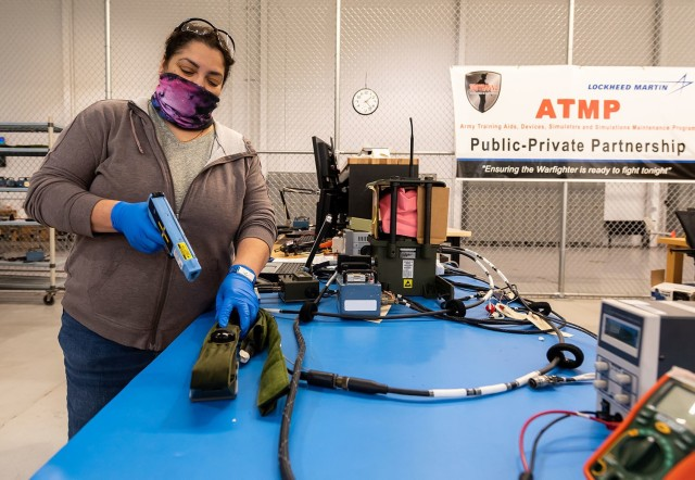 Cleide McLaughlin, electronics mechanic, tests the detector belt for a MILES XXI system.