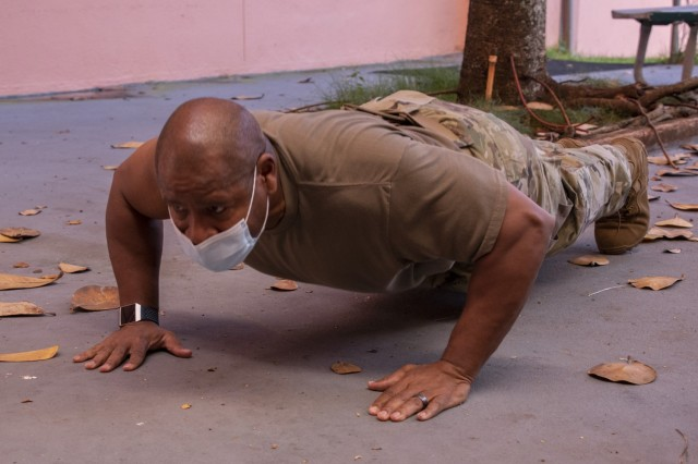 Lt. Col. Ronald Cole, Public Health Command-Pacific's Human Health Services director and a public health nurse, does push-ups after receiving the first dose of the Pfizer vaccine at Tripler Army Medical Center, Honolulu, on Dec. 23, 2020. Cole explained that push-ups help relieve the side effect of having a sore arm after receiving a vaccine. He recommended that Soldiers do push-ups, if possible, if they normally tend to experience soreness after an inoculation.