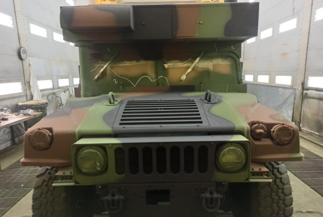 An Army humvee gets a facelift and a fresh coat of paint at Leghorn Army Depot's paint shop in Livorno, Italy. The humvee is one of 55 vehicles being re-painted that belong to the 405th Army Field Support Brigade's Army Prepositioned Stock-2.