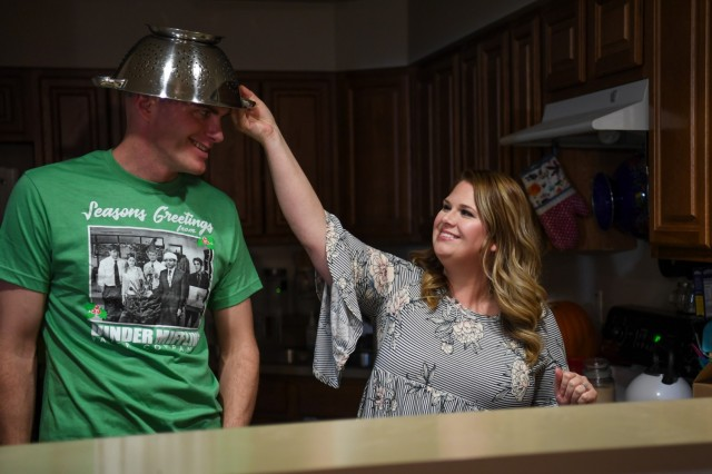 1st Lt. Matthew Mickey has fun preparing dinner with his wife, Denise. Mickey married Denise 15 years ago after meeting her while stationed at Fort Knox, Ky. After spending his childhood in foster care, Denise, his 9-year-old daughter, Lily, and his fellow Soldiers are his only family. (U.S. Army photo by Lara Poirrier)