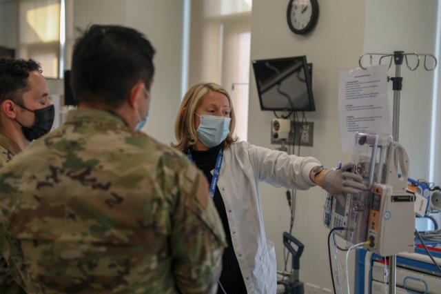 A U.S. Air Force medical provider assigned to Travis Air Force Base, Calif., trains on an Alaris Pump Module for his deployment at the Riverside University Healthcare System on Jan. 7, 2021, in Riverside, California. U.S. Northern Command, through U.S. Army North, remains committed to providing flexible U.S Department of Defense support to the whole-of-America COVID-19 response. (U.S. Army Photo by Spc. Preston Robinson)