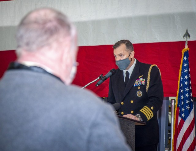 U.S. Navy Capt. Gregory Leland, executive assistant for the Under Secretary of the Navy, introduces the Honorable Gregory J. Slavonic during a ceremony to recognize U.S. Army Sgt. Dan Crowley (ret.) at Bradley Air National Guard Base in Windsor Locks, Conn. Jan. 4, 2021. During this ceremony, Crowley officially received his rank of sergeant, the Prisoner of War Medal, and the Combat Infantry Badge, which he earned during his service in the Pacific Theatre of World War II but was never officially recognized prior to his separation from the service.