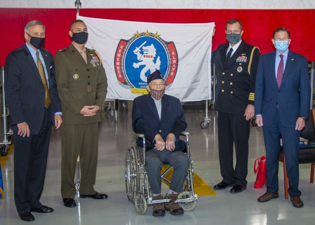 From left-to-right, the Honorable Gregory J. Slavonic, currently performing the duties of Under Secretary of the Navy, U.S. Marines Col. Stephen Lightfoot, military advisor to the Under Secretary of the Navy, U.S. Army Sgt. Dan Crowley (ret.), U.S. Navy Capt. Gregory Leland, executive assistant for the Under Secretary of the Navy, and U.S. Sen. Richard Blumenthal pose for a photo following a ceremony at the Bradley Air National Guard Base in Windsor Locks, Conn. Jan. 4, 2021. The ceremony presented Crowley with his official promotion to sergeant, the Prisoner of War Medal, and the Combat Infantry Badge, which he earned while serving in the Pacific Theatre of World War II but never received prior to his separation from the service.