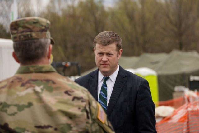 Army Secretary Ryan D. McCarthy speaks with Maryland Adjutant General Maj. Gen. Timothy Gowen while visiting a COVID-19 screening site in Landover, Md., in this file photo from March 31, 2020.