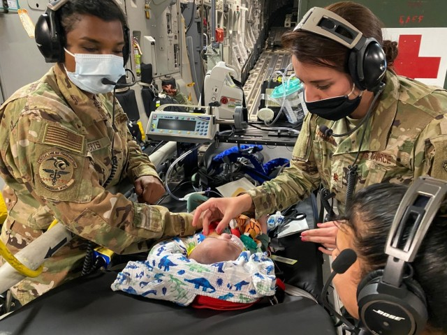 A 59th Medical Wing Pediatric Critical Care Air Transport Team provides care to a five-month-old patient on board a C-17 Globemaster III headed to California, Oct. 9, 2020. The patient and his family were traveling from the neonatal intensive care unit in Hawaii to Texas.  (Courtesy photo)