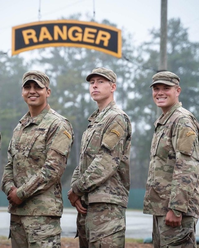 (left to right) Sgt. 1st Class Miguel Zarate, Spc. Carl Siberski and Spc. Blayne Adams pose for a photo after graduating Ranger School at Fort Benning, Georgia, Nov. 12, 2020. The three Soldiers are assigned to 1st Battalion, 64th Armor Regiment, 1st Armored Brigade Combat Team, 3rd Infantry Division. These Soldiers began training for the school during the height of the COVID-19 pandemic, adding a layer of difficulty to the already challenging training regimen that precedes Ranger School attendance.
