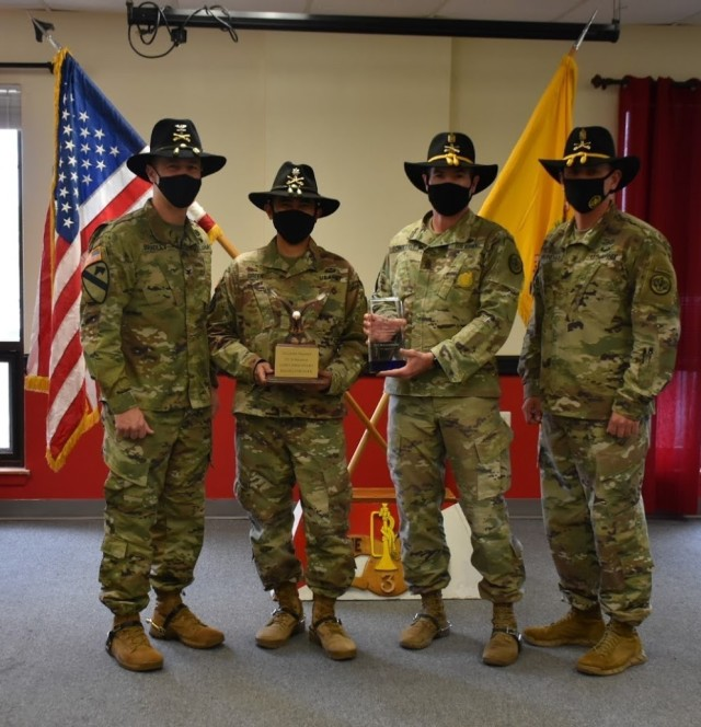 3d Cavalry Regiment Commander, Col. Kevin Bradley and Command Sgt. Maj. present the Regimental Support Squadron Commander, Lt. Col. Danilo Green and Command Sgt. Maj. David Schoettle with Retention Early Bird and the Top Retention Unit Award for 2020 during a presentation on January 8 at Fort Hood, Texas. (U.S. Army photo by Maj. Marion Jo Nederhoed)