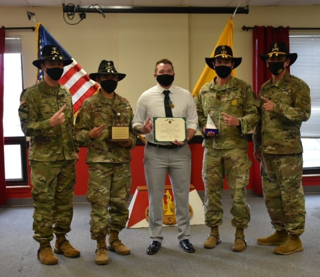 3d Cavalry Regiment Commander, Col. Kevin Bradley and Command Sgt. Maj. and Regimental Support Squadron (RSS) Commander, Lt. Col. Danilo Green and Command Sgt. Maj. David Schoettle award Staff Sgt. Jamie Moyer, RSS Retention Counselor with the Army Commendation Medal for his efforts that resulted in Muleskinner Squadron receiving the Retention Early Bird and the Top Retention Unit Award for 2020. The awards were presented during a ceremony on January 8 at Fort Hood, Texas. (U.S. Army photo by Maj. Marion Jo Nederhoed)