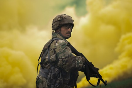 Cpl. Patrick Schubert, U.S. Army Reserve petroleum supply specialist representing the 377th Theater Sustainment Command, keeps security amidst yellow smoke during a military police scenario during the 2020 U.S. Army Reserve Best Warrior Competition at Fort McCoy, Wis., Sept. 8, 2020.