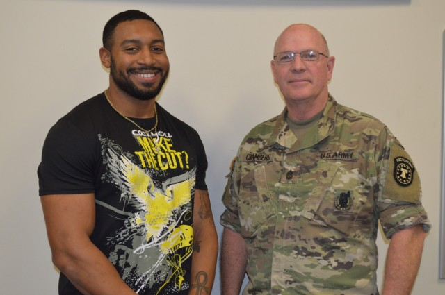Former University of Alabama running back De'Marquise Lockridge stands with Columbia (Tenn.) U.S. Army recruiter Sgt. 1st Class Paul Chambers. Lockridge was a member of the Crimson Tide's 2017 NCAA Football championship team, and was a teammate of Tennessee Titans' All-Pro Derrick Henry.