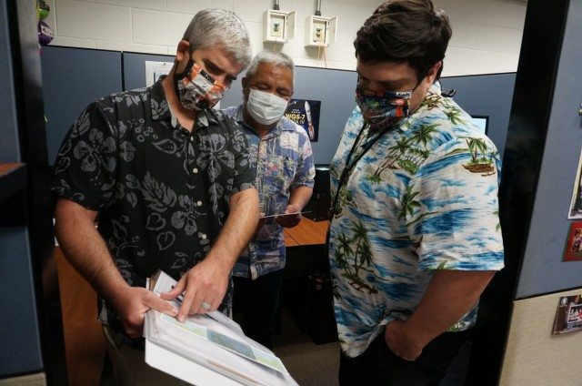 Wideband satellite communication planners from the Regional Satellite Communication Support Center-Pacific at Wheeler Army Air Field, Hawaii, discuss satellite planning options  to support a customer's request for SATCOM resources in March 2020. The RSSC-Pacific belongs to the U.S. Army Satellite Operations Brigade, U.S. Army Space and Missile Defense Command. (Photo courtesy of Iwalani Gutierrez/RELEASED)
