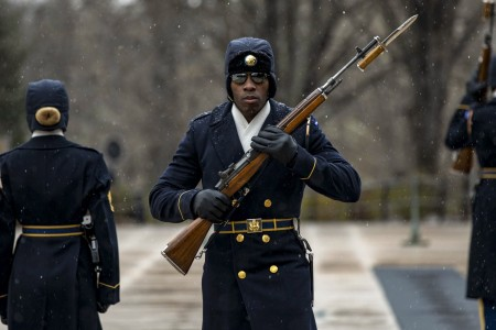 "Soldiers assigned to the 3rd U.S. Infantry Regiment, known as ""The Old Guard,"" maintain vigil during the first snowfall of the season at the Tomb of the Unknown Soldier at Arlington National Cemetery in Virginia, Dec. 16, 2020."