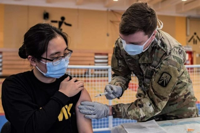 Army Spc. Hana Lee, a dental specialist assigned to the Baumholder Army Dental Clinic, receives her first dose of the COVID vaccine. Dental care providers and staff were included as part of the initial distribution since performing dental procedures puts them at high risk for exposure to COVID-19