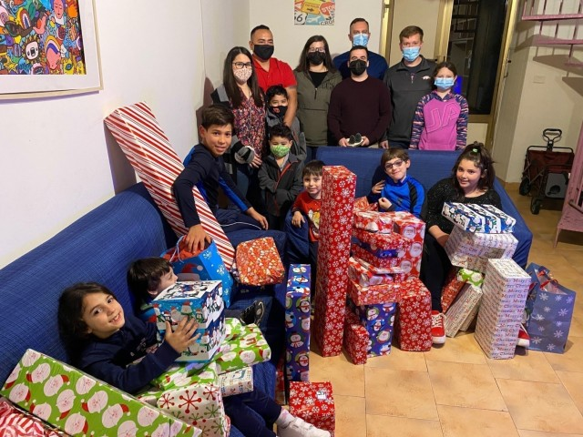 Soldiers from the Joint Tactical Ground Station-Italy at Naval Air Station Sigonella, Sicily, give more than 50 gifts to local Italian children at the Alba Chiara Orphanage in Acireale, Dec. 21, 2020, as part of an annual detachment toy drive organized by Staff Sgt. Paul Gutierrez and Sgt. Collin Crutchfield. (Courtesy photo)