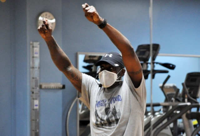Rodney Holloway, Nightclub Cardio fitness instructor, leads his fitness class at the Yano Fitness Center, Camp Zama, Japan, Jan. 16.