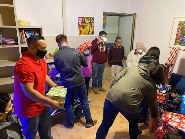 Staff Sgt. Paul Gutierrez, Joint Tactical Ground Station-Italy at Naval Air Station Sigonella, Sicily, delivers gifts to local Italian children at the Alba Chiara Orphanage in Acireale as part of a holiday toy drive, Dec. 21, 2020. The JTAGS unit in part of 1st Space Company, 1st Space Battalion, 1st Space Brigade, U.S. Army Space and Missile Defense Command. (Courtesy photo)