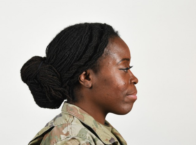 """A female Soldier poses for an example photo wearing """"locs"""" and multiple hairstyles to illustrate an upcoming change to Army grooming and appearance standards. Soldiers will be authorized to wear multiple hairstyles if they can maintain a neat and professional appearance, and if the hairstyle doesn't impede the use of headgear or other equipment."""