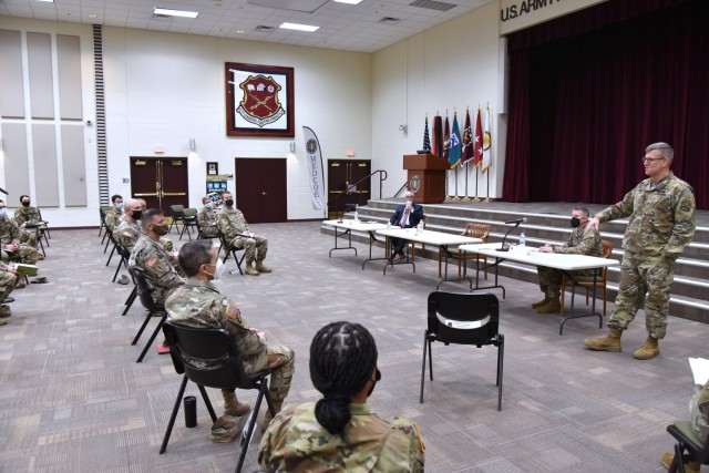Lt. Gen. James Rainey, Commanding General, U.S. Army Combined Arms Center (CAC) and Fort Leavenworth, Kansas, addresses MEDCoE commanders and leaders while Mr. J. M. (Jay) Harmon III, SES, Deputy to the Commanding General MEDCoE, look and Command Sgt. Maj. Clark J. Charpentier, MEDCoE Command Sergeant Major, look on.
