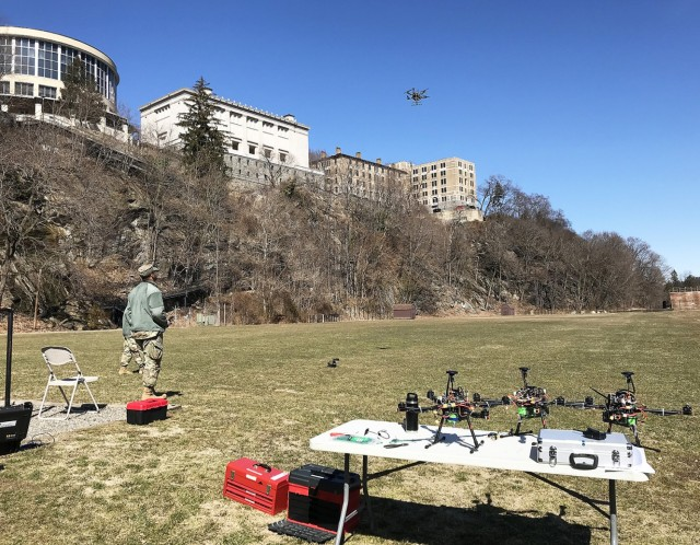 West Point Radiation Assessment and Tracking Hive (WRATH) team designed and demonstrated a multi-Unmanned Aircraft Systems system to aid in forensic analysis of a post nuclear blast environment. In this 2019 photo, a cadet completes a test flight of one of the swarm's 12 drones. (Courtesy Photo)