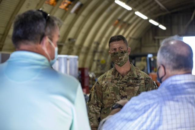 Army Sustainment Command's commanding general Maj. Gen. Daniel Mitchell listens to 402nd AFSB's deputy to the commander Joe Schulz and ASC's director of support operations Dan Reilly explain the challenges feeding Soldiers at remote training facility Pōhakuloa Training Area.