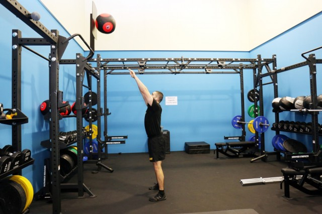 "Staff Sgt. Miguel Garcia, assigned to the 311th Military Intelligence Battalion, throws a ""wall ball"" in the new functional fitness area of the Yano Fitness Center, Camp Zama, Japan, Jan. 21."