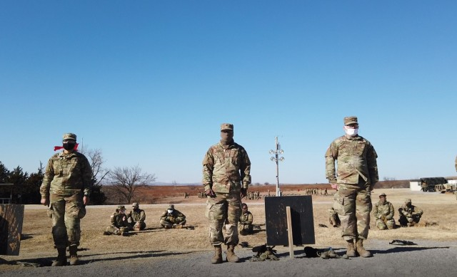 Basic Combat trainees stand ready to walk down their rifle marksmanship lane and see if they zeroed their weapons Jan. 14, 2021, at Fort Sill, Oklahoma. About 3,000 trainees who left for holiday block leave were tested for COVID-19 on their return with less than 2 percent testing positive.  They are now in a controlled monitoring phase in which they will train in bay formations instead of normal platoon formations. They will be screened once more after the two weeks are up.
