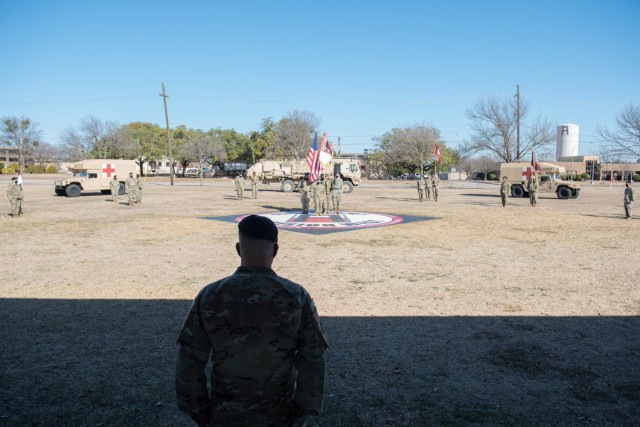Col. Roger Giraud, Commander, 1st Med. Bde., looks to his new unit formation before the ceremony comes to an end.  The 1st Medical Brigade held a change-of-command ceremony Jan. 14 on Cameron Field between Robert Howe II, and new 1st Med. Bde. Commander, Col. Roger Giraud. (U.S. Army by Sgt. 1st Class Kelvin Ringold)