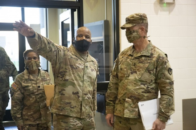 Col. Landis Maddox, commander of the 25th Division Sustainment Brigade, shows Army Sustainment Command's commanding general Maj. Gen. Daniel Mitchell the 25th ID consolidated dining facility known as the Sustainment Bistro.