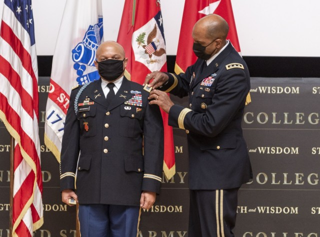 Col. Okera Anyabwile, director of the Strategic Simulations Division at the U.S. Army War College, being promoted by one of his mentors, Lt. Gen. Gary Brito, Army deputy chief of staff, G-1.