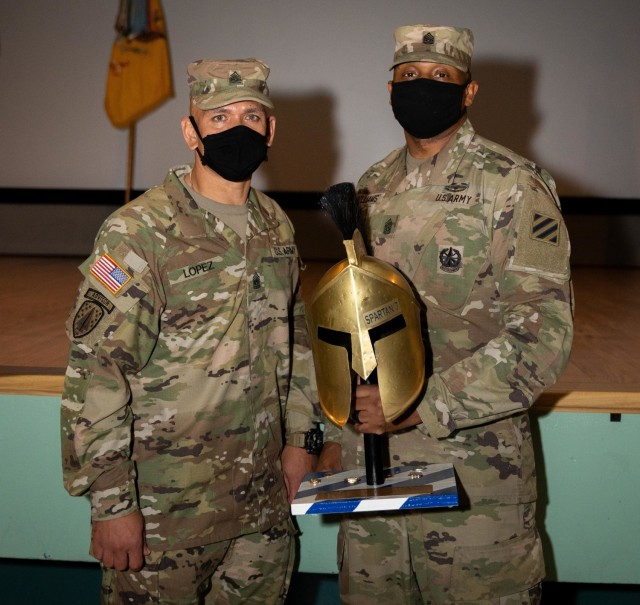Incoming senior enlisted advisor, Command Sgt. Maj. Jaime Lopez of the 2nd Armored Brigade Combat Team, 3rd Infantry Division, takes a picture with outgoing Command Sgt. Maj. Jabari O. Williams after a change of responsibility ceremony, Jan. 22, 2021, at Woodruff Theater on Fort Stewart, Georgia. The ceremony marks the official transition of authority as Command Sgt. Maj. Lopez assumes responsibility for the brigade. (U.S. Army photo by Spc. Devron Bost)