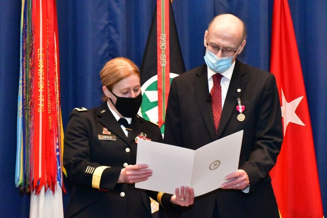 Brig. Gen. Heidi Hoyle, Military Surface Deployment and Distribution Command commanding general, presents Dr. Kent Beck, command historian, a certificate during his retirement ceremony January 22, 2021 at Scott Air Force Base, Illinois. Beck retired after more than 36 years of federal service.