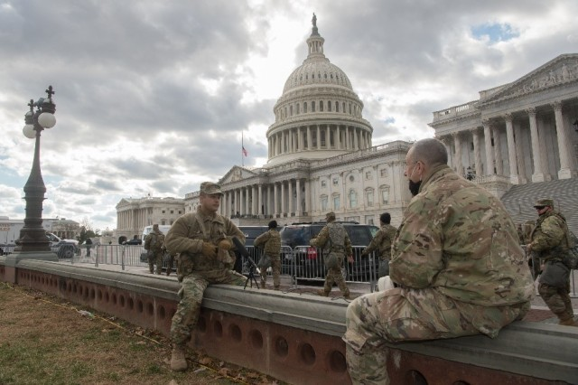 Chaplain Ervid Reyes, a member of the Texas Army National Guard answers questions by Sergeant 1st Class Jerry Saslav, with the 126th Military History Detachment, in front of the U.S. Capitol prior to the 59th Presidential Inauguration in Washington,D.C., January 17, 2021. The 126th MHD and 315th MHD traveled to Washington, D.C. capture historical data during this time in American history.