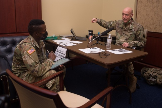 Cpt. Julian Woodhouse, team leader of the 315th Military History Detachment, Annville, Pa, interviews Command Sgt Major Robert H. Purkerson, Jr., Operations SGM of the 29th Infantry Division from Fort Belvoir, Va. at Joint Forces Headquarters Washington, D.C., January 17, 2021. The 29th ID is supporting the 59th Presidential Inauguration.