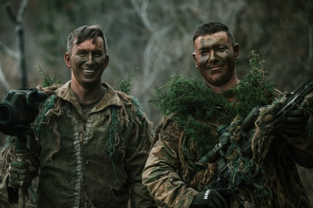 Spc. Jarrod Thomas and Cpl. Dalton Palmer, both Snipers with 1st Battalion, 12th Cavalry Regiment, 3rd Armored Brigade Combat Team, 1st Cavalry Division, pose for a photo as a two-man team after completing a successful mission during a movement, cover, and concealment training exercise, Fort Hood, Texas, Jan. 20, 2021. (U.S. Army photo by Sgt. Calab Franklin)