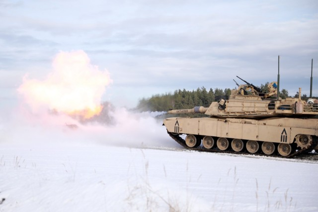 An M1 Abrams Main Battle Tank assigned to 1st Squadron, 7th Cavalry Regiment, 1st Armored Brigade Combat Team, 1st Cavalry Division, fires its 120mm main gun at Grafenwoehr Training Area, Germany, Jan. 21, 2021.