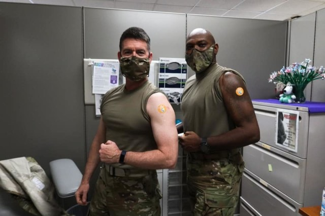 FORT BENNING, Ga. – The COVID-19 vaccine is being made available here on a voluntary basis and on Jan. 2, two key leaders got their first vaccine: Maj. Gen. Patrick J. Donahoe (left), commanding general of the U.S. Army Maneuver Center of Excellence and Fort Benning, and Command Sgt. Maj. Derrick C. Garner, MCoE's senior enlisted leader. Donahoe later discussed availability of the vaccine during a virtual town hall meeting live-streamed Jan. 21. He also announced a partial easing of COVID-19 restrictions, that later took effect Jan. 25.(U.S. Army photo by Markeith Horace, Maneuver Center of Excellence and Fort Benning Public Affairs)