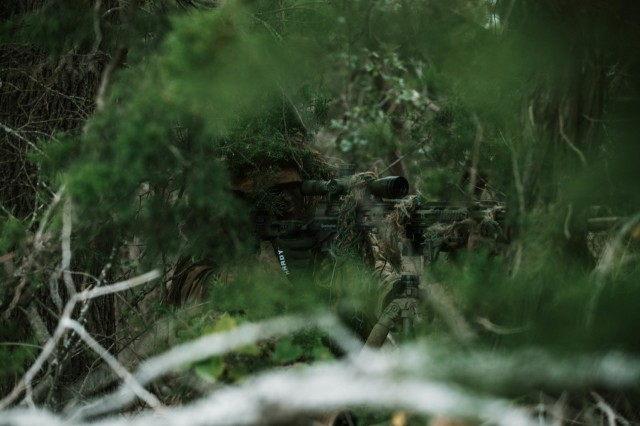 Spc. Jarrod Thomas, a Sniper with 1st Battalion, 12th Cavalry Regiment, 3rd Armored Brigade Combat Team, 1st Cavalry Division, scopes in on an enemy during a movement, cover, and concealment training exercise, Fort Hood, Texas, Jan. 20, 2021. (U.S. Army photo by Sgt. Calab Franklin)
