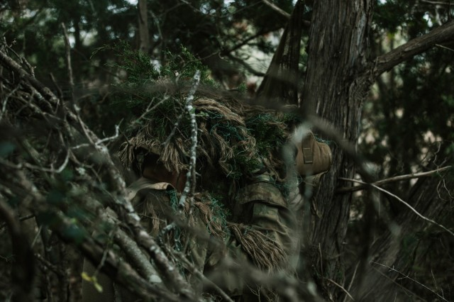 Cpl. Dalton Palmer, a Sniper with 1st Battalion, 12th Cavalry Regiment, 3rd Armored Brigade Combat Team, 1st Cavalry Division, looks to spot an enemy during a movement, cover, and concealment training exercise, Fort Hood, Texas, Jan. 20, 2021. (U.S. Army photo by Sgt. Calab Franklin)