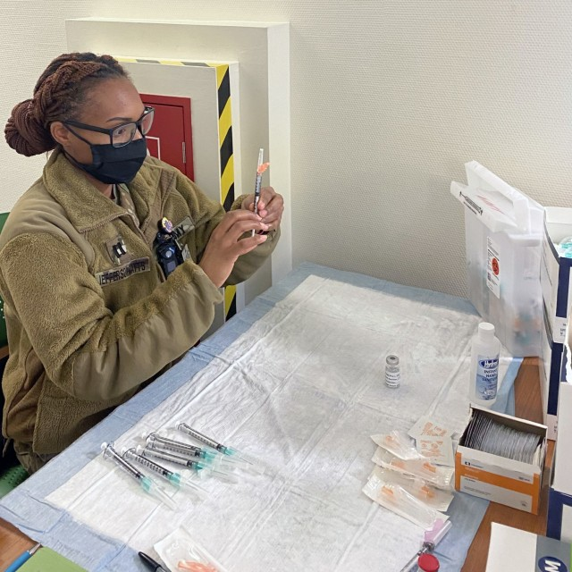 Capt. Ashley Jefferson-Watts, a clinical nurse and officer in charge of the primary care clinic at U.S. Army Health Clinic Grafenwoehr, prepares a Moderna COVID-19 vaccine.