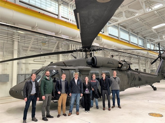 Former University of Colorado Boulder students gather in front of a UH-60 Blackhawk helicopter during a previous Designing for Defense course. Designing for Defense is a semester-long course offered at U.S. research universities that provide Department of Defense leaders with the opportunity to collaborate with college student teams to develop innovative solutions to pressing national security problems. (Courtesy photo)